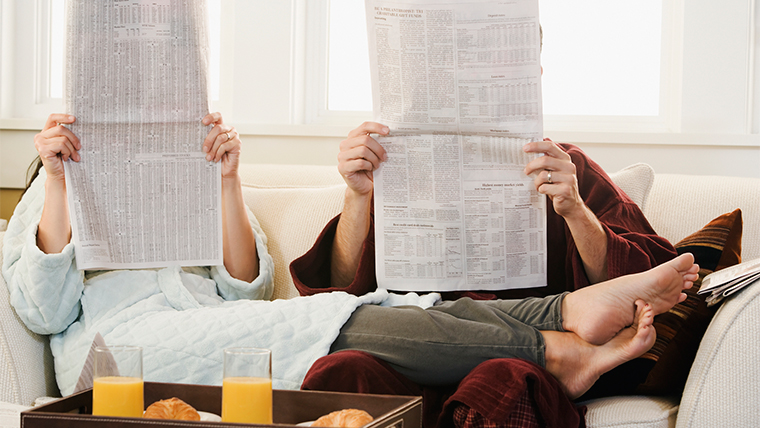 couple reading a newspaper;the image used for foreign exchange rates