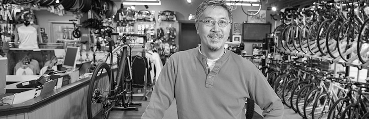 Bicycle shop owner. Image used for HSBC Fusion Get Rate page.