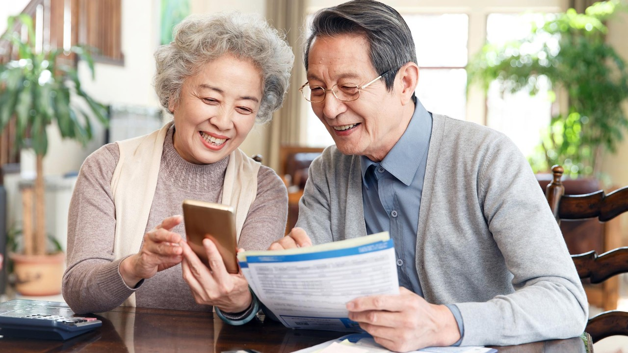 elder couple are searching information; the image used for long-term financial management plan for your family